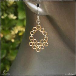 sculptural scroll style earrings by elfin alchemy