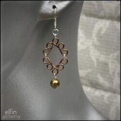 scroll style earrings with Swarovski pearl